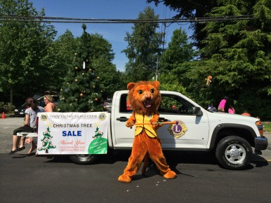The Lynn Valley Lion reminds everyone to get their Christmas trees from the Lions, and see your money do some good in the community!