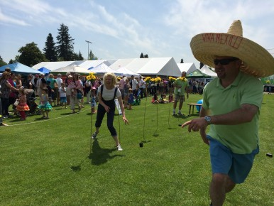 LVLIfe sponsoring realtor Jim Lanctot, looking dashing in a sombrero, coaches a Masters category runner through the obstacle course.