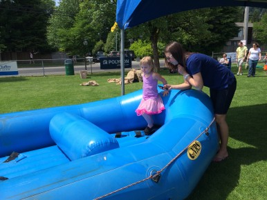 A ballerina gets instructions and encouragement from a LVLifer as she starts out on the SuperKids Obstacle Course.