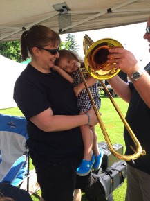 This Black Bear Band niece is getting an early intro to the art of the trombone from Uncle Jeff Seddon, a member of the band's 'Impalers' t-bone section.